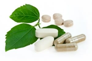 Natural pills with green leaf